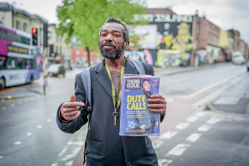 Big Issue seller in Bristol