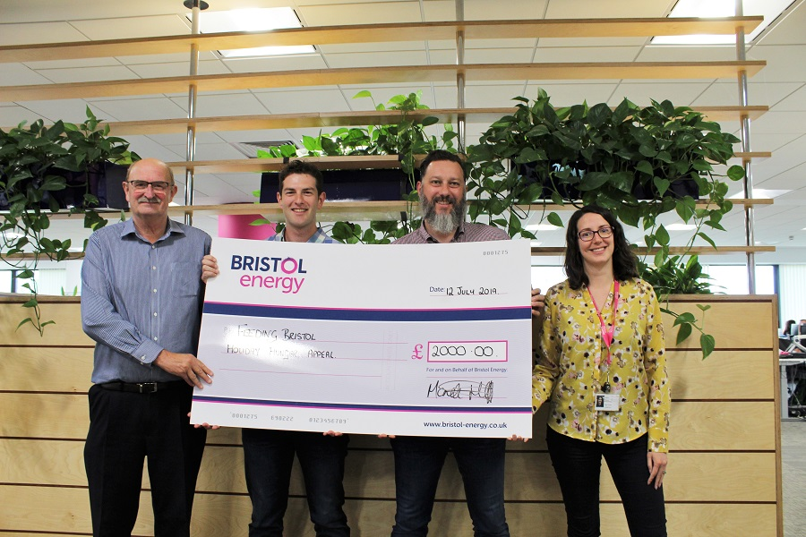 Bristol Energy staff presenting giant cheque