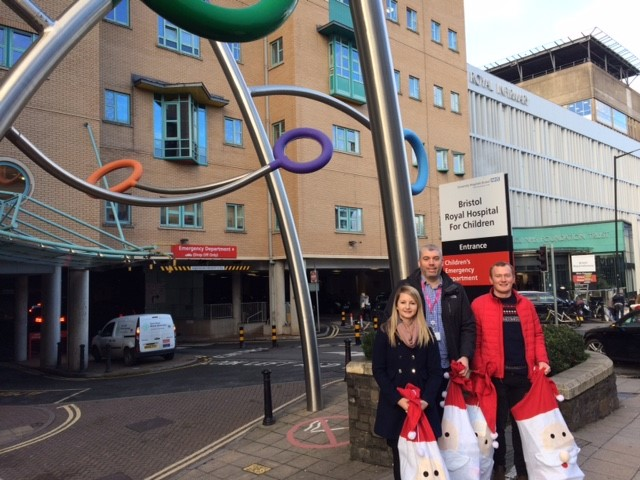 Bristol Energy staff delivering christmas presents to Bristol Royal Children's Hospital