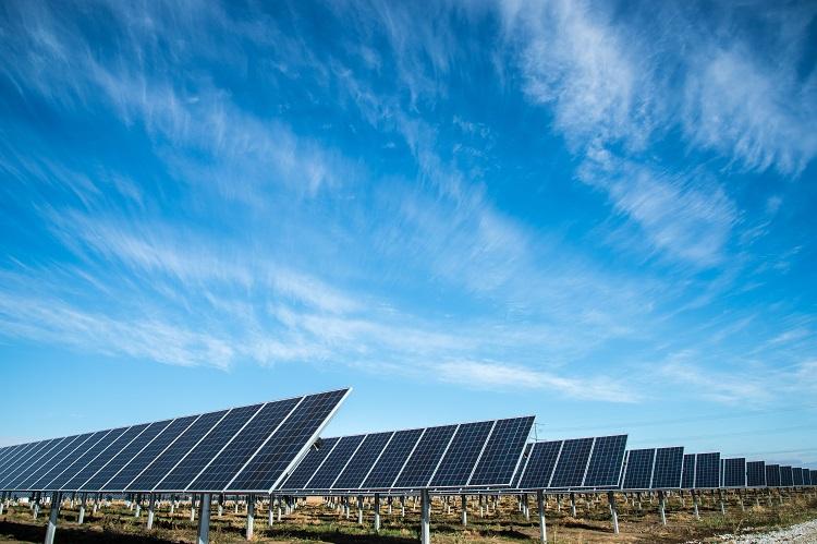 Solar panels under a bright blue sky