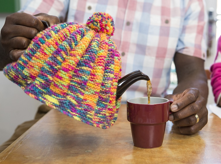 Teapot in knitted tea cosy
