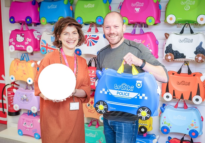 Man and woman with Trunki cases